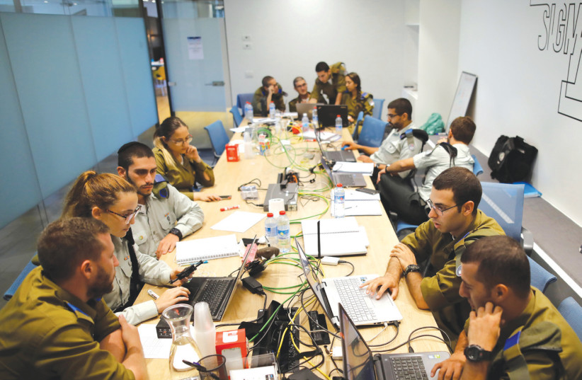 IDF SOLDIERS take part in a cyber security training course at the iNT Institute of Technology and Innovation in Beersheba in August (photo credit: REUTERS/AMIR COHEN)