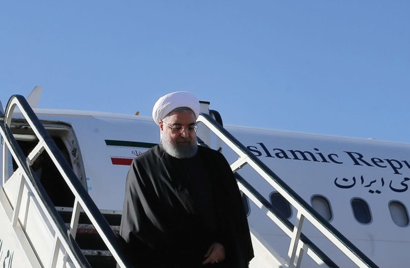 IRANIAN PRESIDENT Hassan Rouhani walks down aircraft steps as he arrives at Kermanshah near the areas worst hit by the earthquake. (photo credit: REUTERS)