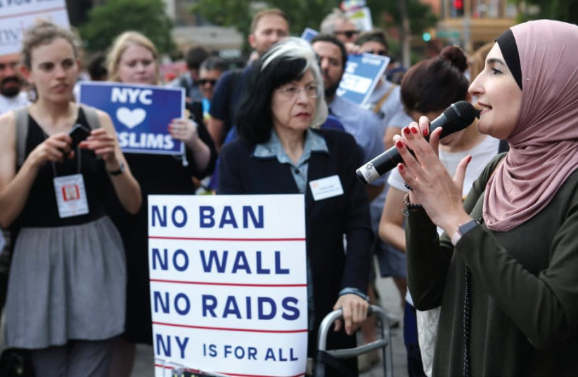 Activist Linda Sarsour speaks at a June protest in New York City against US President Donald Trump's limited travel ban (photo credit: REUTERS/JOE PENNEY)