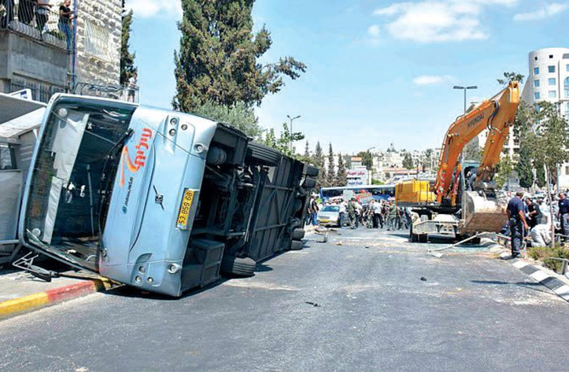 Bus flipped by tractor in Jerusalem terror attack. (photo credit: Wikimedia Commons)