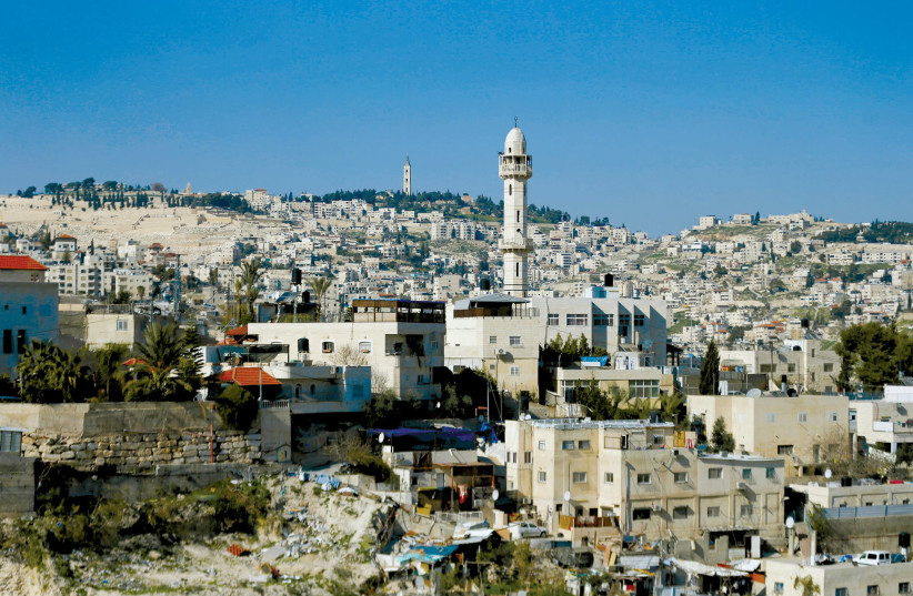THE MINARET of a mosque is seen near the East Jerusalem neighbourhood of Silwan (photo credit: REUTERS)