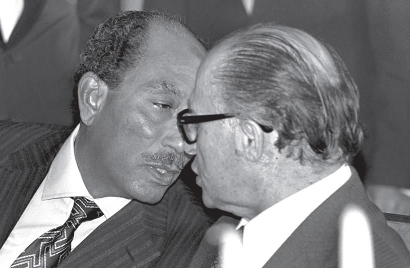ANWAR SADAT and Menachem Begin chat during the former Egyptian president's historic visit to Jerusalem in 1977.  (photo credit: REUTERS)
