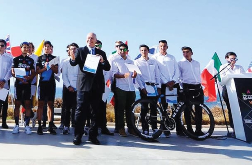 The Israel Cycling Ac ademy's 2018 24-rider team was introduced yesterday and awarded the title of Peres Center 'Ambassador for Peace' at a ceremony in Tel Aviv. (photo credit: BRIAN HODES/VELO IMAGES)