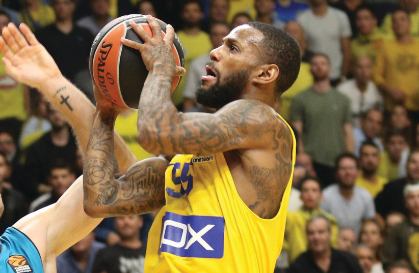 Maccabi Tel Aviv guard Pierre Jackson led his team with 19 points in last night's 77-69 victory at Khimki Moscow in Euroleague action. The yellow-and-blue improved to a 5-3 record.  (photo credit: ADI AVISHAI)