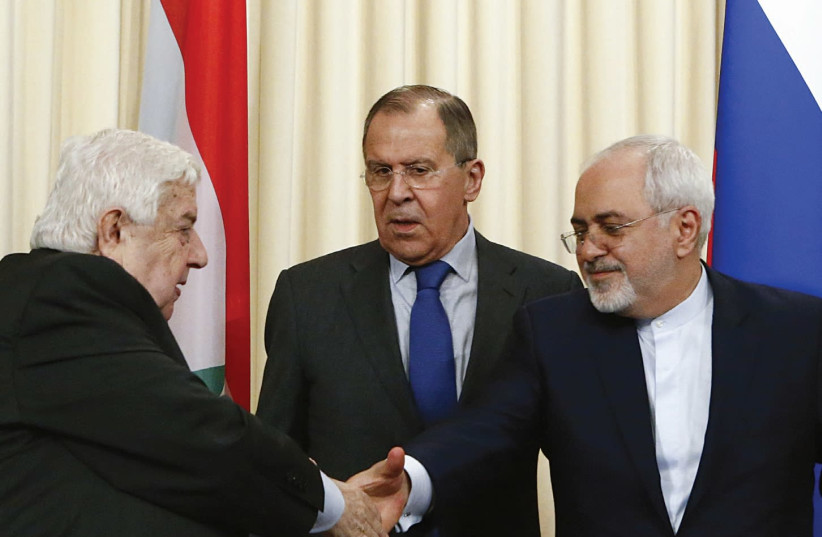 FOREIGN MINISTERS Sergei Lavrov (C) of Russia, Walid al-Muallem (L) of Syria and Mohammad Javad Zarif of Iran attend a news conference in Moscow in April. (photo credit: REUTERS)