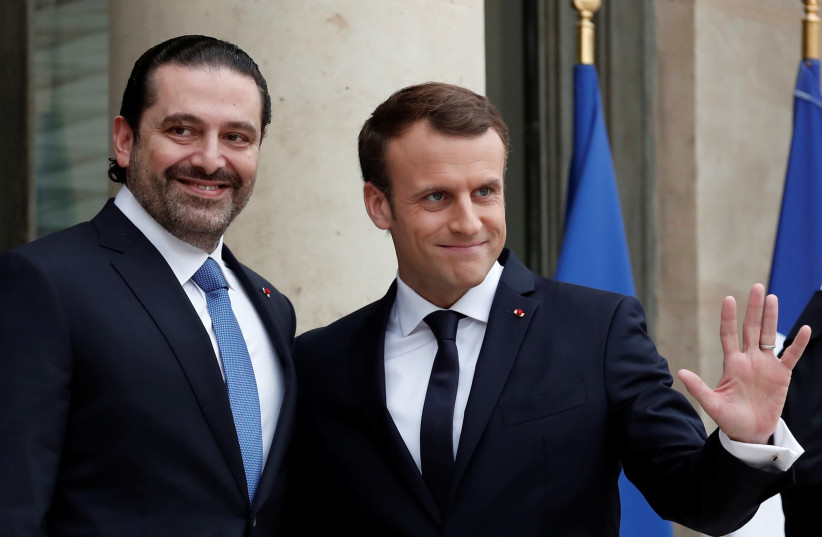 French President Emmanuel Macron and Saad al-Hariri, who announced his resignation as Lebanon's prime minister while on a visit to Saudi Arabia, react on the steps of the Elysee Palace in Paris, France, November 18, 2017.  (photo credit: BENOIT TESSIER /REUTERS)