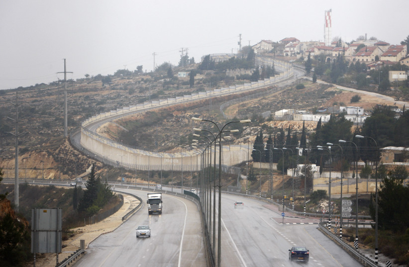 Vehicles drive on Highway 443 past the West Bank Jewish settlement of Beit Horon (photo credit: AMMAR AWAD / REUTERS)