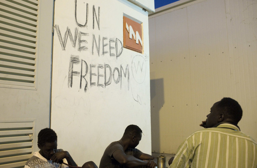 African migrants sit at the Holot open detention center in the Negev in Southern Israel (photo credit: FINBARR O'REILLY / REUTERS)