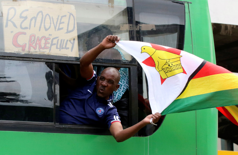 A man calling for Zimbabwean President Robert Mugabe to step down protests in Harare, Zimbabwe (photo credit: REUTERS/PHILIMON BULAWAYO)
