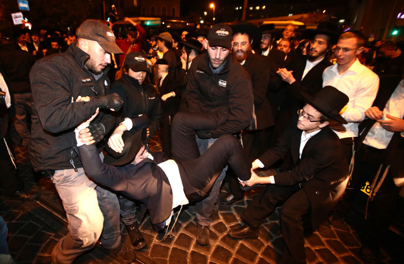 Extremist haredi men protest against jail sentences for draft dodgers. (photo credit: MARC ISRAEL SELLEM/THE JERUSALEM POST)