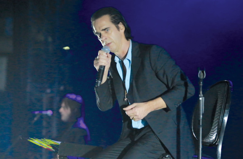 Australian musician Nick Cave performs to a sold-out audience at Nokia Arena in Tel Aviv yesterday. Nick Cave and the Bad Seeds kicked off their two-day concert series last night, taking the audience on a musical journey with songs both old and new. Cave, who stood up to pressure from the BDS moveme (photo credit: ORIT PNINI)