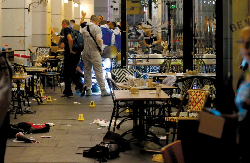 Police work the scene of the June 8, 2016, shooting attack at a restaurant at the Sarona Market in Tel Aviv (photo credit: AMMAR AWAD/REUTERS)