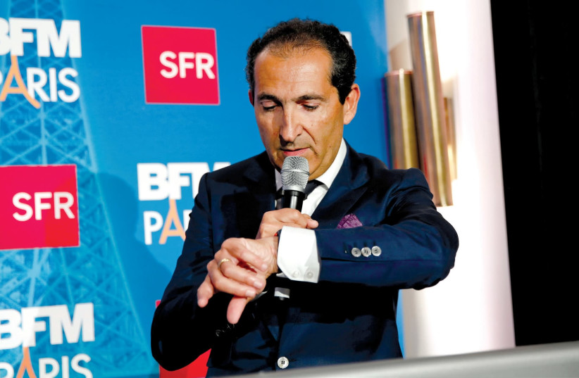 Franco-Israeli billionaire Patrick Drahi may no longer be the richest man in Israel following the plummeting of his company's stock price (photo credit: BENOIT TESSIER /REUTERS)