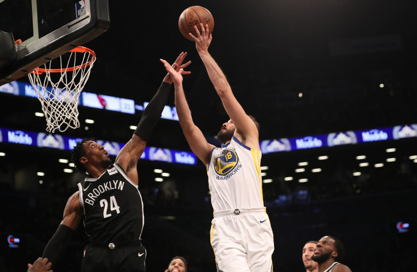 Golden State Warriors forward Omri Casspi shoots over Brooklyn Nets forward Rondae Hollis-Jefferson during the first quarter at Barclays Center.  (photo credit: ANTHONY GRUPPUSO-USA TODAY VIA REUTERS)