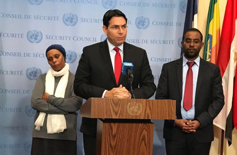 Ambassador Danny Danon with Agarnesh and Ilan Gashao Mengistu (photo credit: COURTESY/ISRAEL UN MEDIA)