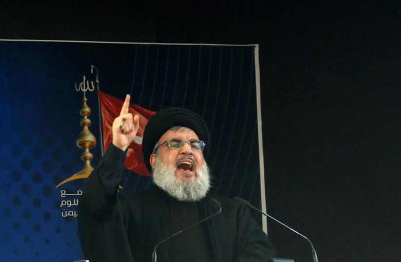 Hezbollah leader Sayyed Hassan Nasrallah delivers a speech (photo credit: REUTERS)