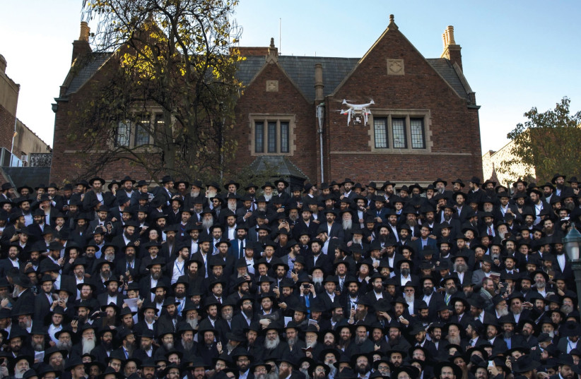 CHABAD members pose for a photo at their New York headquarters. (photo credit: REUTERS)