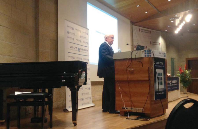 PROF. JAMES HECKMAN of the University of Chicago speaks at the Taub Center conference in Jerusalem yesterday. (photo credit: SARAH LEVI)