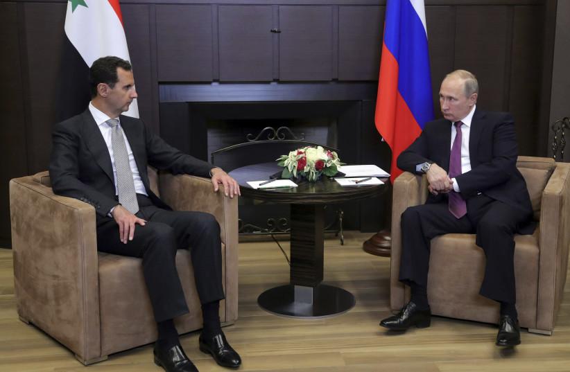 Russian President Vladimir Putin meets with Syrian President Bashar Assad in Sochi, Russia, November 2017 (photo credit: SPUTNIK PHOTO AGENCY / REUTERS)