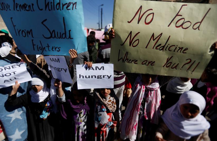 Yemeni children protest the Saudi-led coalition's blockade of their country, November 2017 (photo credit: REUTERS/KHALED ABDULLAH)