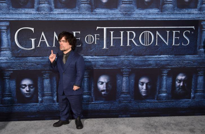 """Cast member Peter Dinklage attends the premiere for the sixth season of HBO's """"Game of Thrones"""" in Los Angeles.  (photo credit: PHIL MCCARTEN/REUTERS)"""