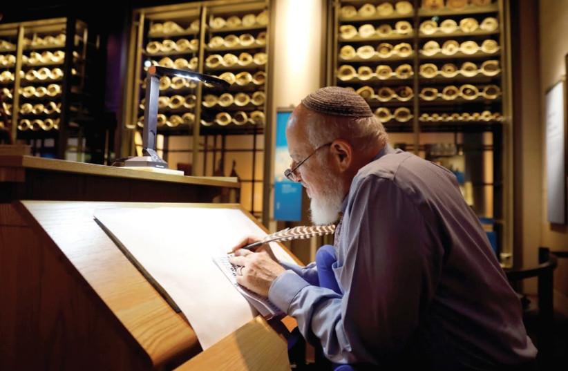 RABBI ELIEZER ADAM works on the Sefer Torah at Washington's Museum of the Bible last week (photo credit: KEVIN LAMARQUE/REUTERS)