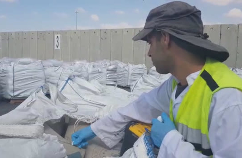 A security inspector checks materials at Kerem Shalom Crossing (photo credit: DEFENSE MINISTRY)