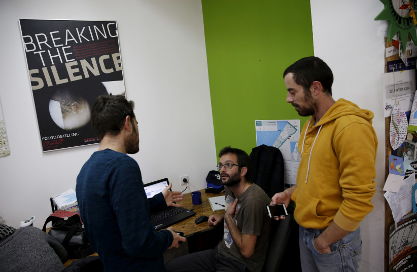 """Employees work at the offices of Israeli rights group """"Breaking the Silence"""" in Tel Aviv, Israel, December 16, 2015 (photo credit: BAZ RATNER/REUTERS)"""