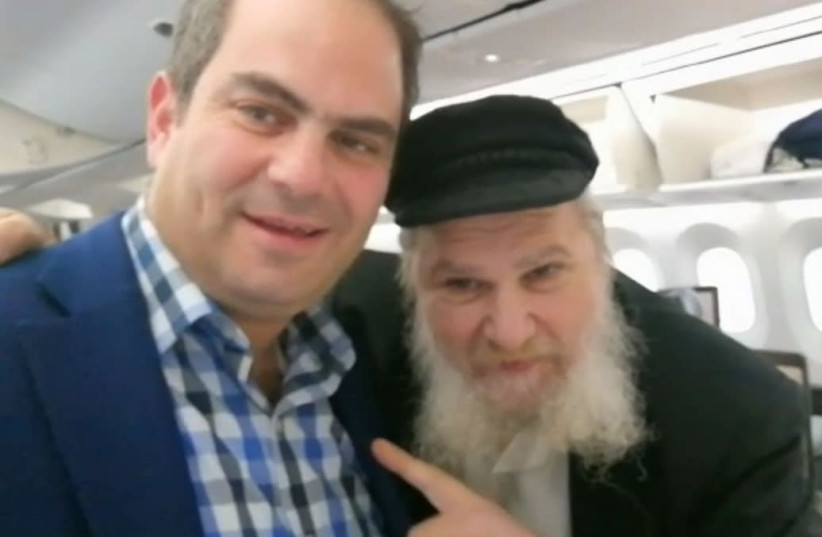 Eli Beer and his patient exiting the plane - with permission from the patient to use this image. (photo credit: UNITED HATZALAH)