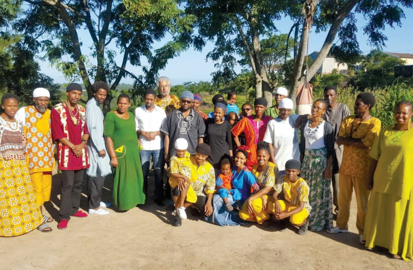 MEMBERS OF the AHI community in East London, South Africa, with Dimona community leader, Minister Ahmadiel Ben Yehuda (the tallest) in the center. (photo credit: Courtesy)
