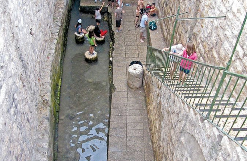 TOURISTS VISIT Jerusalem's ancient Shiloah (Siloam) pool, the place where pilgrims would immerse before ascending to the Temple Mount. (photo credit: Wikimedia Commons)