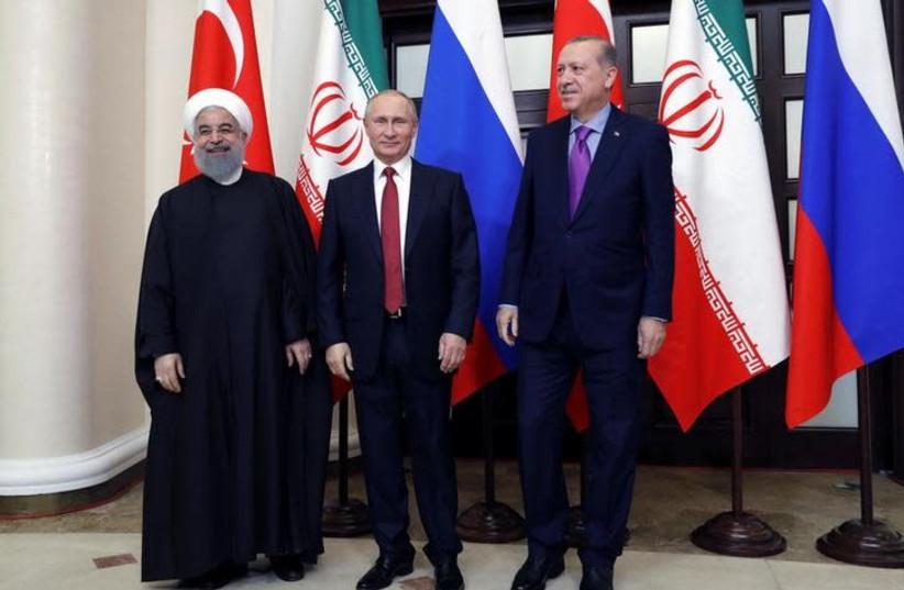 Iran's President Hassan Rouhani, Russia's Vladimir Putin and Turkey's Tayyip Erdogan meet in Sochi, Russia November 22, 2017 (photo credit: SPUTNIK/MIKHAIL METZEL/KREMLIN VIA REUTERS)