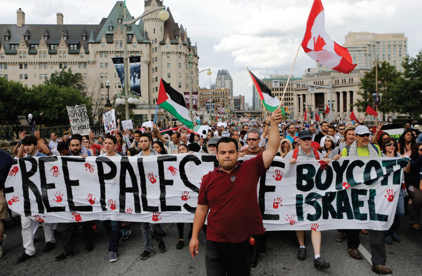 PRO-PALESTINIAN PROTESTERS take part in a demonstration against Israel's military action in the Gaza Strip, in Ottawa. (photo credit: REUTERS)