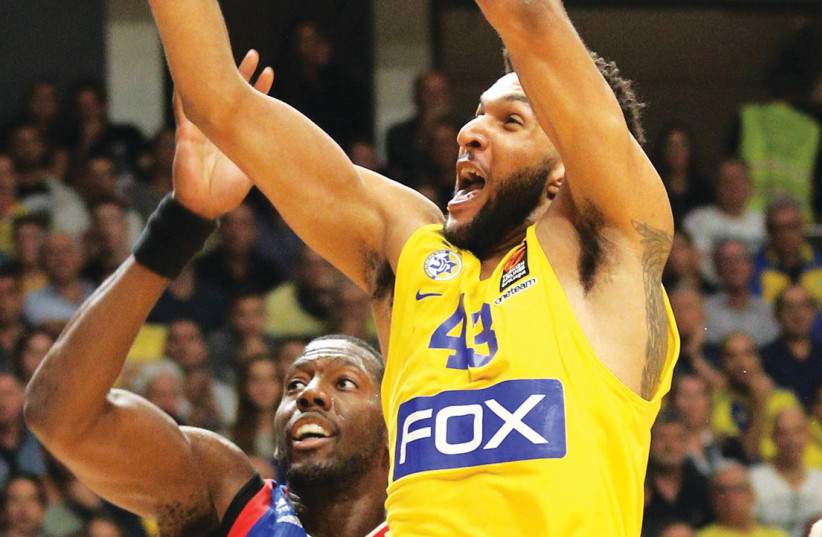 Maccabi Tel Aviv forward Jonah Bolden has finally settled at the team after an erratic start, averaging 10.0 points and 7.3 rebounds over the past three Euroleague game ahead of tonight's encounter with Barcelona in Spain. (photo credit: ADI AVISHAI)