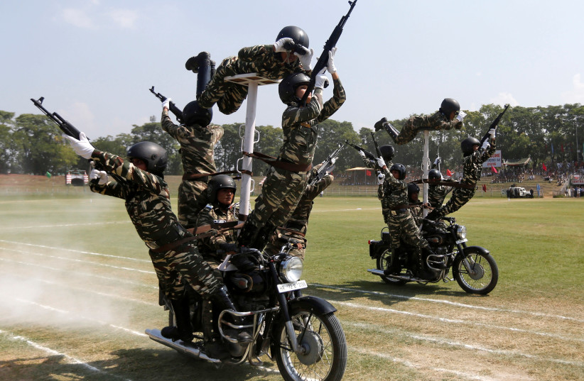 Indian policewomen perform a stunt on their motorbikes (photo credit: REUTERS/DANISH ISMAIL)