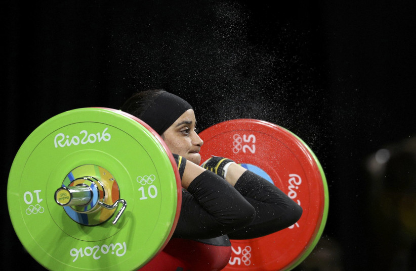 Samira Ouass (MAR) of Morocco competes in the Women's 75kg Rio 2016 Olympics Weightlifting Final (photo credit: REUTERS)