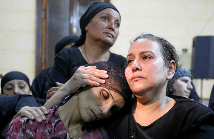 A mother of one of the victims of an attack on a group of Coptic Christians attends a funeral at the Sacred Family Church in Minya (photo credit: MOHAMED ABD EL GHANY/REUTERS)
