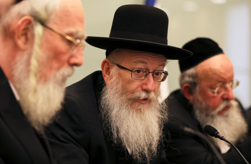 Israel's Deputy Health Minister, Yaakov Litzman (C) from United Torah Judaism party attends a meeting at the Knesset, Israel's parliament, in Jerusalem September 13, 2017. (photo credit: REUTERS)
