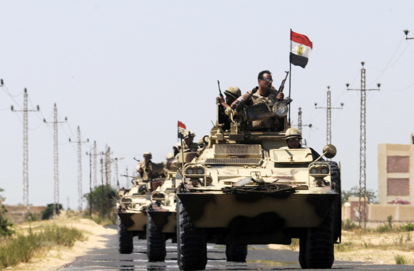 Soldiers in military vehicles proceed towards the al-Jura district in El-Arish city from Sheikh Zuwaid, around 350 km (217 miles) northeast of Cairo May 21, 2013. (photo credit: REUTERS)