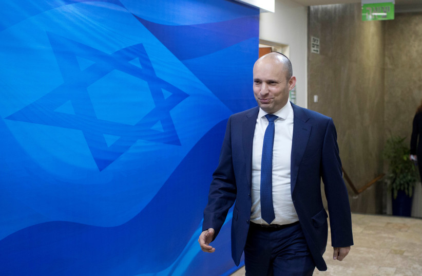 Israeli Education Minister Naftali Bennett arrives to the weekly cabinet meeting at the prime minister office in Jerusalem January 8, 2017.  (photo credit: ABIR SULTAN / REUTERS)
