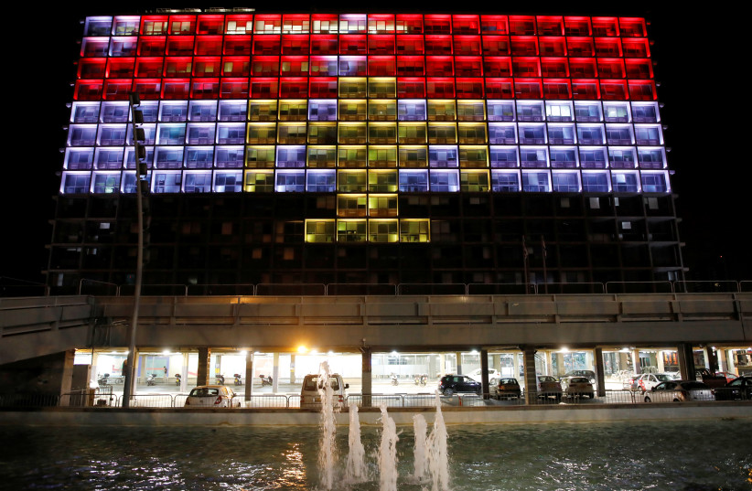 The city hall building in Tel Aviv's Rabin Square in Israel is illuminated in solidarity with Egypt, May 27, 2017.  (photo credit: REUTERS)