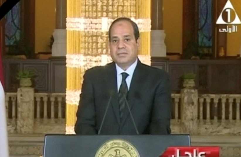 Egyptian President Abdel Fattah Al Sisi gives a televised statement on the attack in North Sinai, in Cairo, Egypt November 24, 2017 (photo credit: EGYPT STATE TV/ VIA REUTERS)