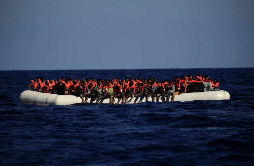 An overcrowded dinghy with migrants from different African countries is seen during a rescue operation off the Libyan coast in the Mediterranean Sea September 21, 2016. (photo credit: REUTERS)