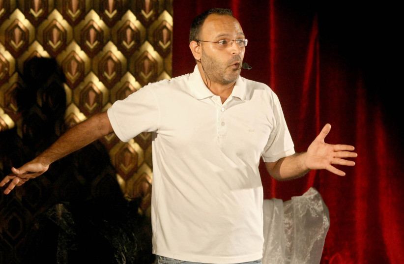 Lebanese writer and actor Ziad Itani performing on stage in the capital Beirut. (photo credit: ANWAR AMRO / AFP)