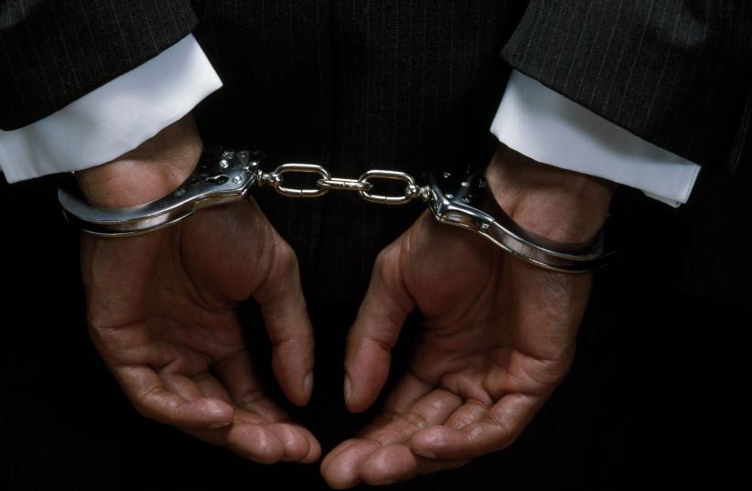 Illustrative photo of handcuffs (photo credit: ING IMAGE/ASAP)