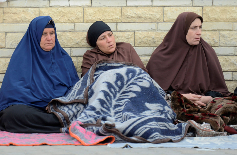 Relatives of victims of the explosion at Al-Rawda mosque, sit outside Suez Canal University hospital in Ismailia, Egypt, 25 November (photo credit: REUTERS/AMR ABDALLAH DALSH)