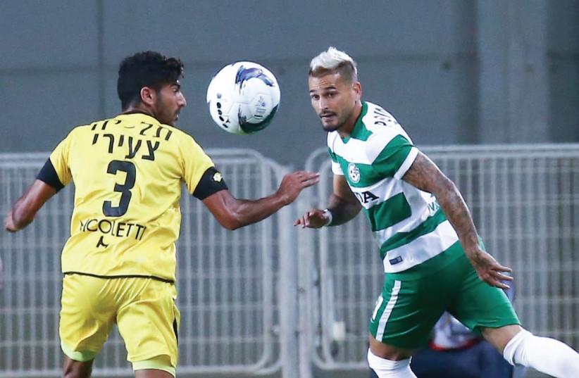 Maccabi Haifa midfielder Maor Buzaglo (right) (photo credit: DANNY MARON)