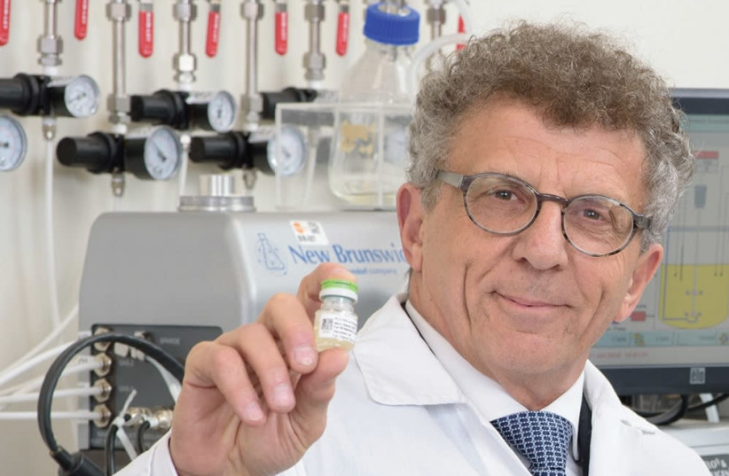 PLURISTEM CHAIRMAN AND CO-CEO Zami Aberman holds a vial of specialized stem cells the company calls 'the next generation of biological therapeutic products.' (photo credit: COURTESY PLURISTEM)