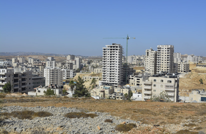 Buildings in Kafr Akab. Out of some 60,000 residents in Kafr Akab, about 52,000 are living in illegal buildings (photo credit: UDI SHAHAM)