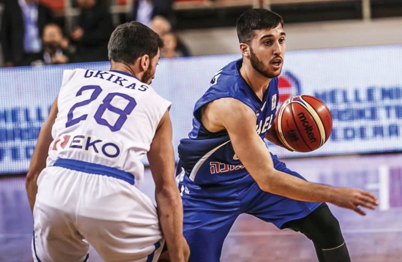 Israel guard Tamir Blatt (right) scored 10 points in last night's 82-61 defeat to Greece in Crete, but also committed five of the team's 26 turnovers. (photo credit: FIBA WEBSITE)